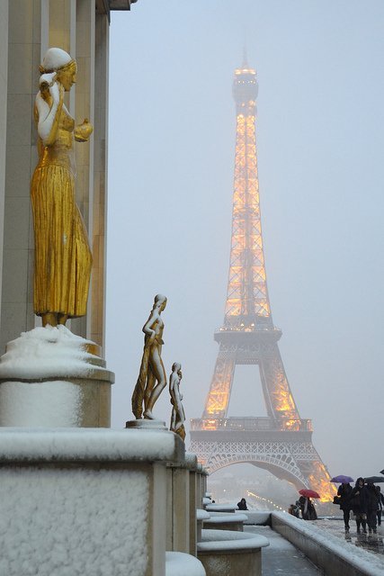 The Eiffel Tower in Paris on snowy evening